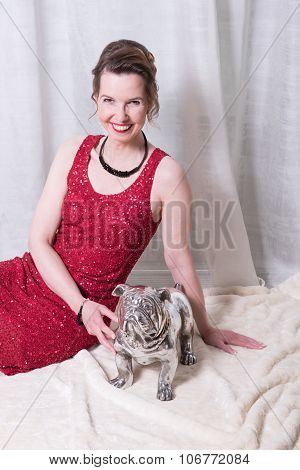 Woman In Red Dress With Dog On Blanket