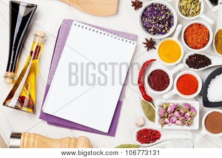 Various spices and condiments on white wooden background. Top view with copy space