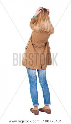 Back view of shocked woman in cloak. girl hid his eyes behind his hands.  Rear view people collection.  backside view of person.  Isolated over white background.