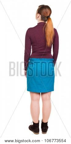 back view of standing young beautiful  woman in jeans. girl  watching. Rear view people collection.  backside view of person.  Isolated over white background. Girl in blue skirt looks up