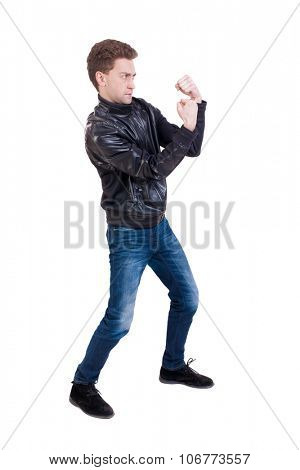 skinny guy funny fights waving his arms and legs. Isolated over white background. Funny guy clumsily boxing