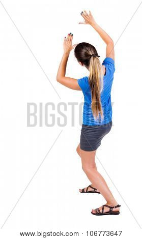 back view of woman  protects hands from what is falling from above. Man holding a heavy load Rear view people collection.  backside view of person.  Isolated over white background.