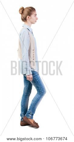 side view of walking  woman in vest. beautiful girl in motion.  backside view of person.  Rear view people collection. Isolated over white background.