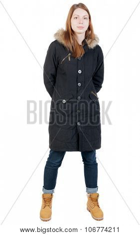 front view woman in winter jacket  looking up.   Standing young girl in parka.  Isolated over white background.
