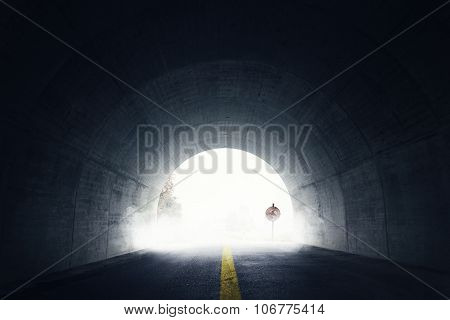 Old Grunge Stop Sign In Fog And Darken Tunnel With Fog And Light At The End Of Tunnel