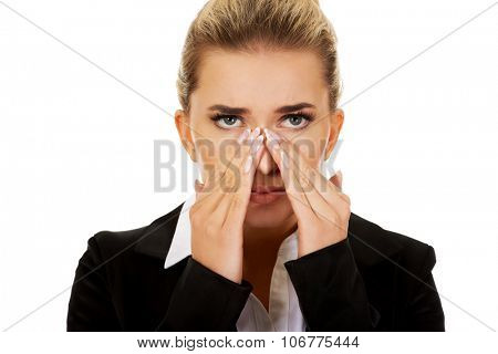 Young businesswoman with sinus ache.