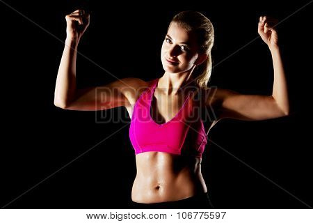 Yong woman shows her muscles