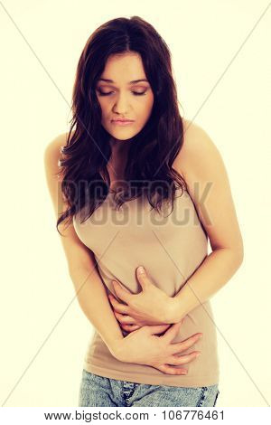 Young student woman suffering from stomachache.