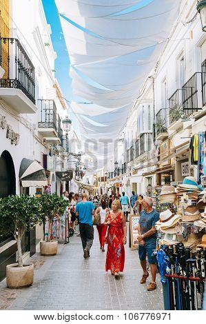 along one of narrow streets in Nerja