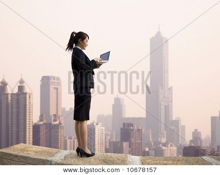 Businesswoman using computer and wireless access