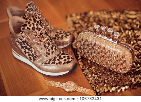Fashion Leopard Sneakers With Glamour Golden Wristwatch And Purse On Wooden Background. Fashion Wome