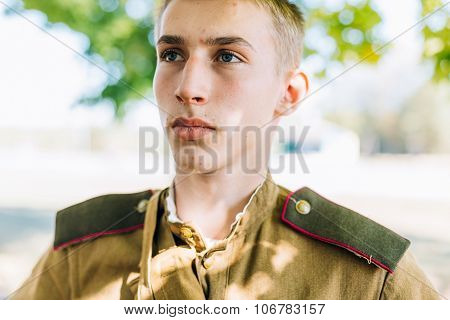Close up of young unidentified re-enactor dressed as Soviet sol