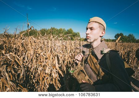 Unidentified re-enactor dressed as Soviet russian soldier goes a
