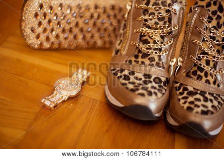 Fashion Womens Accessories. Glamour Golden Wristwatch And Purse, Leopard Sneakers Shoes On Wooden Ba