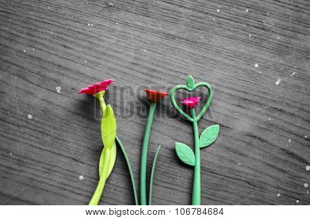 Fake Plastic Flowers On Grungy Background
