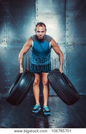 Sportsmen. Fit Male Trainer Man Keeps The Car Tires, Concept  Fitness Workout Strenght Power.