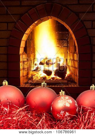 Red Christmas Balls And Tinsel With Fireplace