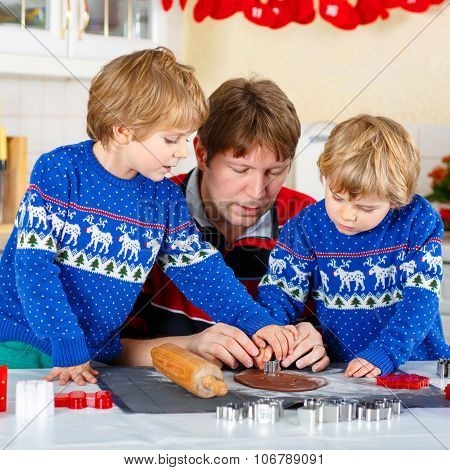 Two Little Kid Boys And Dad Baking Gingerbread Cookies