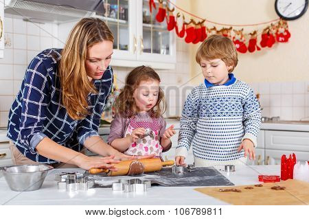 Happy Family Baking Christmas Cookies At Home