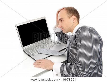 Young Worried Businessman With A Laptop
