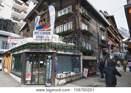 People walk by the street of Zermatt, Switzerland.