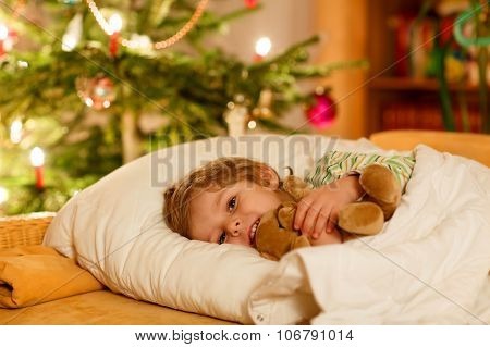 Little Cute Blond Child Sleeping Under Christmas Tree