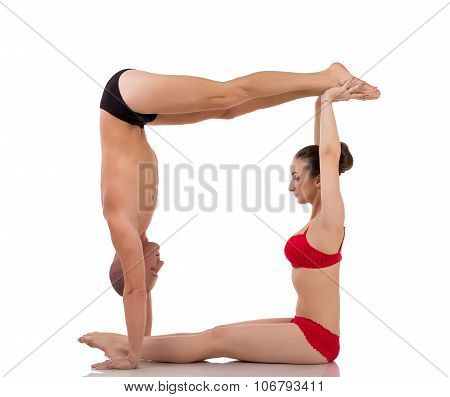 Letter O formed by bodies of yogis