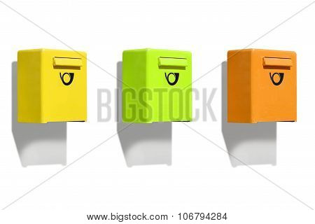 Three colored letterbox on white wall