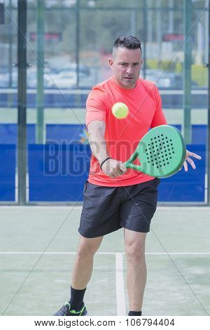 Man Playing Paddle Tennis.