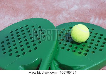 Paddle Rackets And Ball.