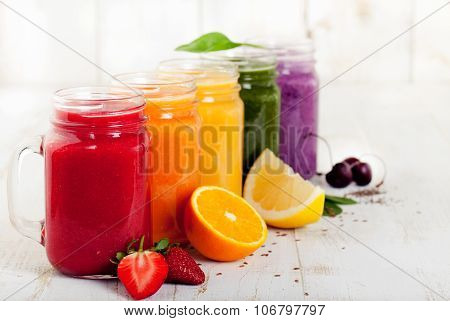 Smoothies, juices, beverages, drinks variety with fresh fruits and berries.