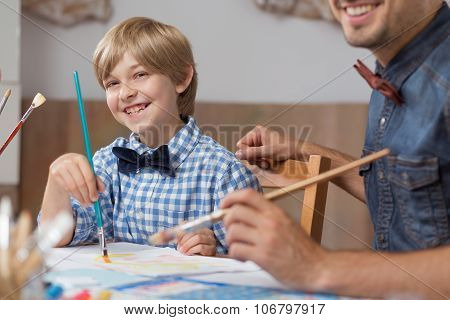 Dad And Son Painting Together