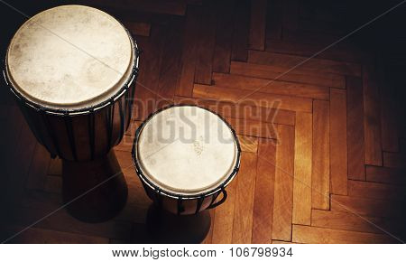 Two Djembes On Parquet