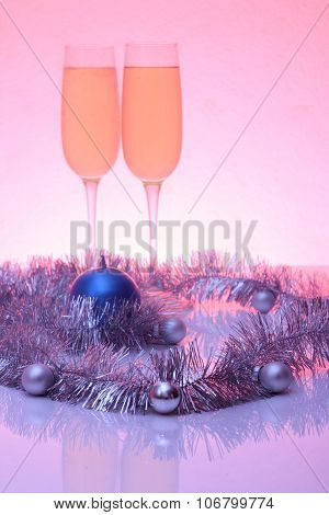 Soft Tinted Photo Of Christmas And New Year Decoration And Two Glasses Of Champagne With Reflection