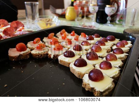 Plate Of Savory With Cheese, Ham, Tomato And Grape