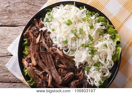 Tasty Pulled Pork And Sauerkraut Close Up On A Plate. Horizontal Top View