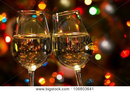 Champagne glasses on the background of Christmas lights