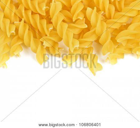 Rotini pasta top view macro on white background