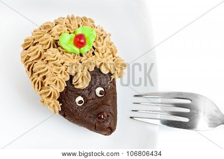Chocolate cake decorated as hedgehog on white dish isolated