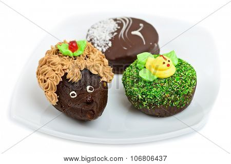 Artistic chocolate cakes decorated as hedgehog, duck and seagull