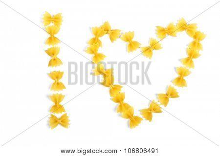 pasta farfalle arranged heart shape isolated on white