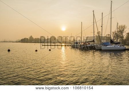 Boats In The Morning Moored On The Lake