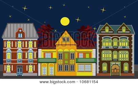 Three residential houses at night