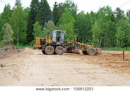 The Grader Clears Away A Ground