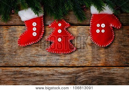 Wood Background With Christmas Tree And Homemade Fleece Toys
