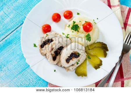 Chicken Roll With Prunes And Nuts On A Wooden Table