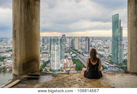 Young Women Meditates In Yoga Position On High Building. Unique Concept Of Meditation, Spirituality