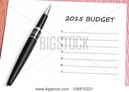 Pen  And Notes Paper With  2015 Budget List