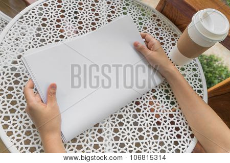 Hand hold Blank Newspaper with empty space mock up