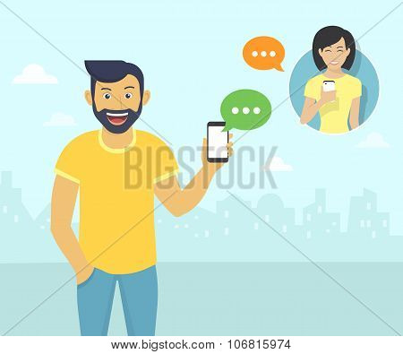 Happy guy is chatting with friends via messenger app